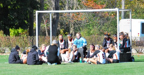 Girls Varsity Field Hockey halftime talk during the St. Ignatius game