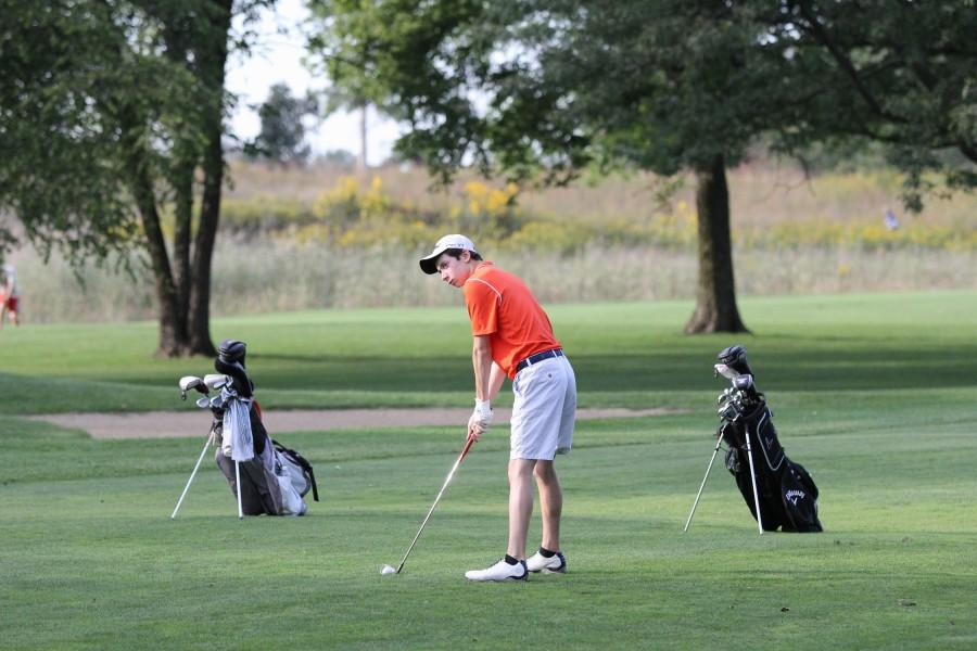 Senior and captain Collin Moody gets ready to tee off.