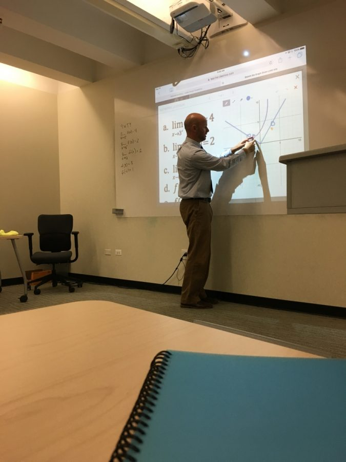 Makovec gets into things right as class begins, and starts teaching the Calculus topic of the  day.