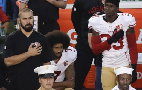 Photo courtesy of CBS News.  Colin Kaepernick kneels during a preseason game in support of Black Lives Matter.