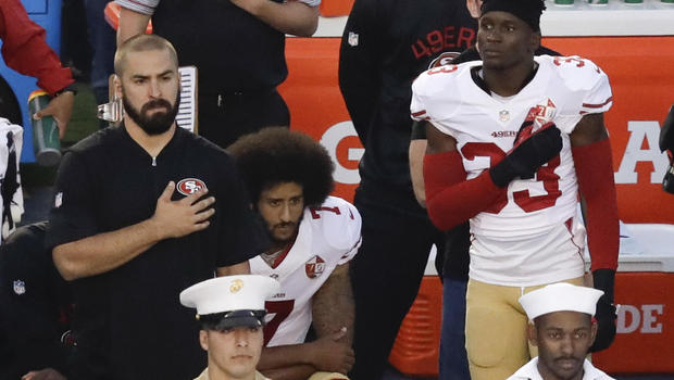 Photo+courtesy+of+CBS+News.++Colin+Kaepernick+kneels+during+a+preseason+game+in+support+of+Black+Lives+Matter.