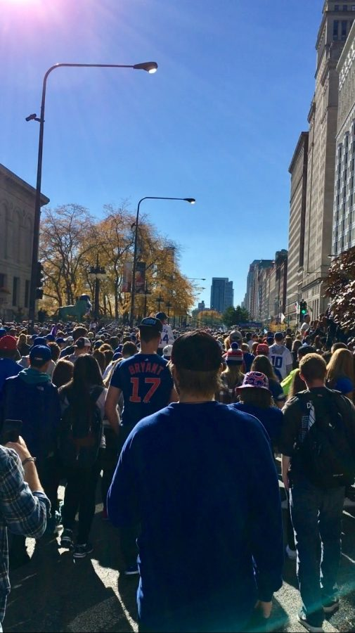 Crowds of people walking through Michigan Avenue to get to Grant park and the Rally