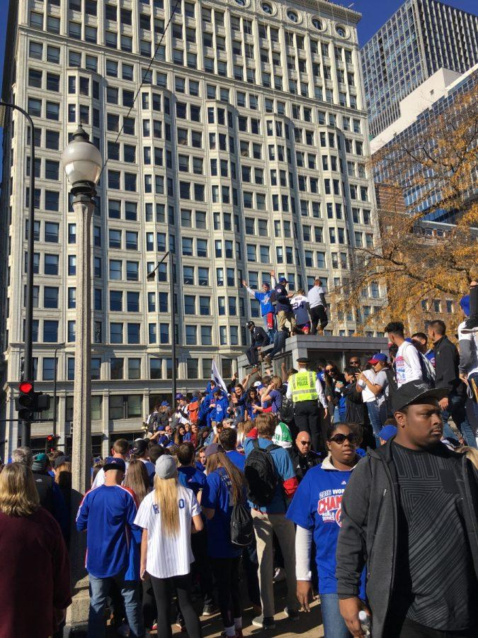 Struggling to see the cubs, people started to climb on public platforms