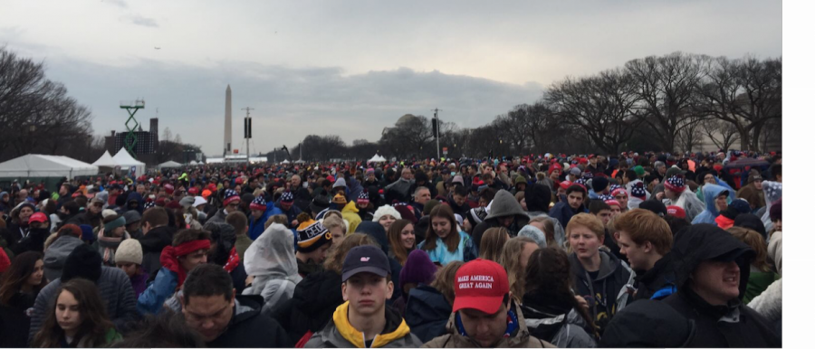 The+crowds+gather+in+front+of+the+Capitol+Building+as+they+wait+for+the+Inauguration+to+start.+