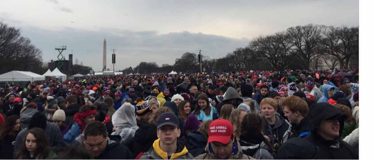 The crowds gather in front of the Capitol Building as they wait for the Inauguration to start.
