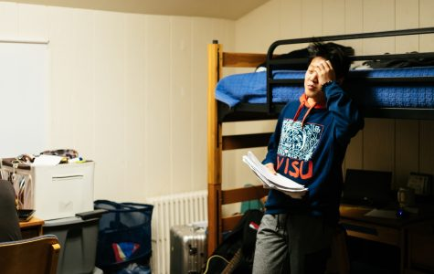 Freshman Tony Lu shows signs of fatigue in his room while studying for a test and balancing dorm life.