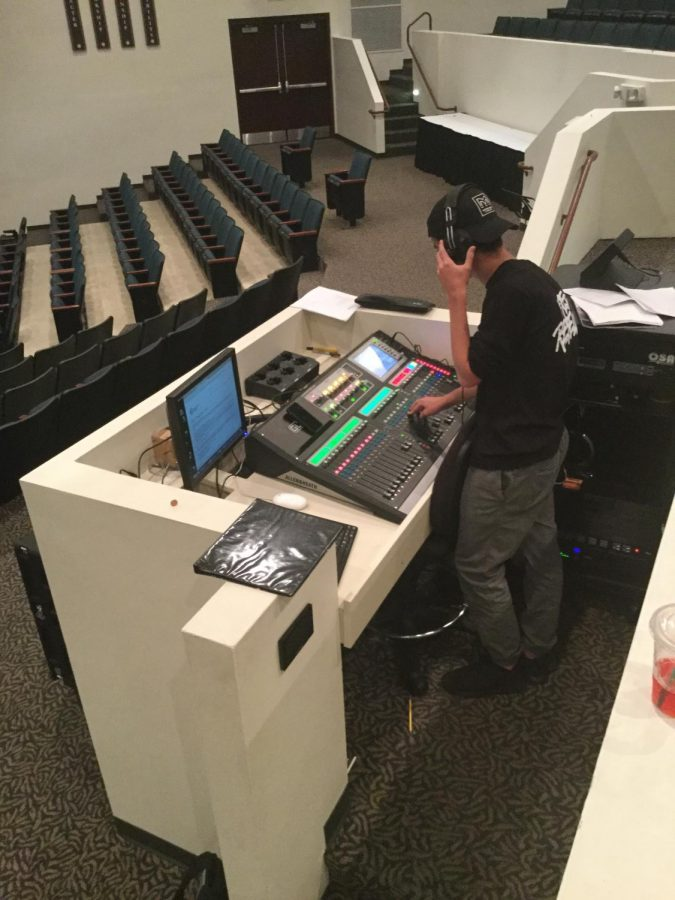 Senior Chris Morrison putting together the finishing touches for audial pieces of the Fall Play.
