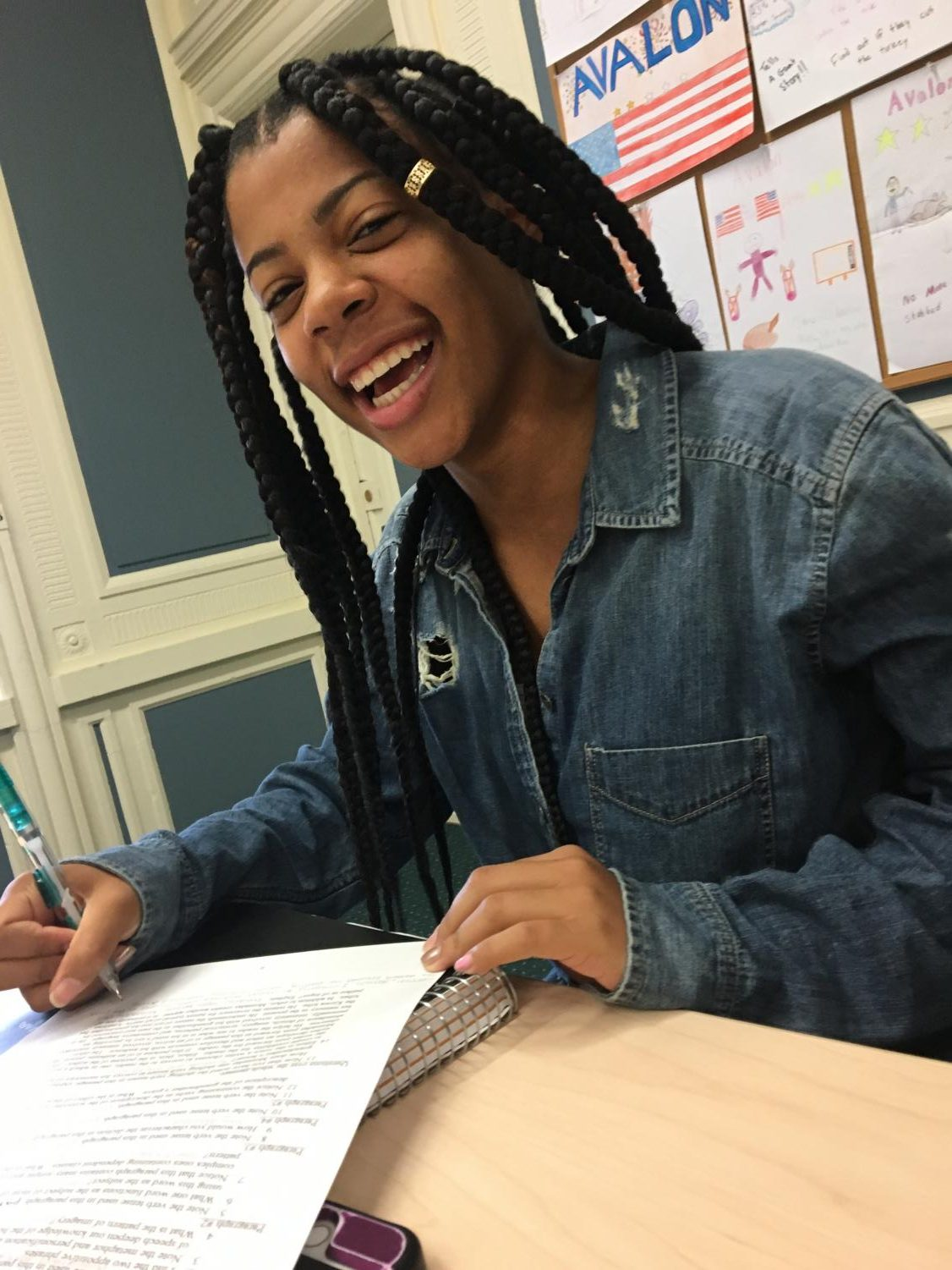 Carrington Newsome, a junior, enjoying AP Lang class in her button down top that happens to be ripped denim!