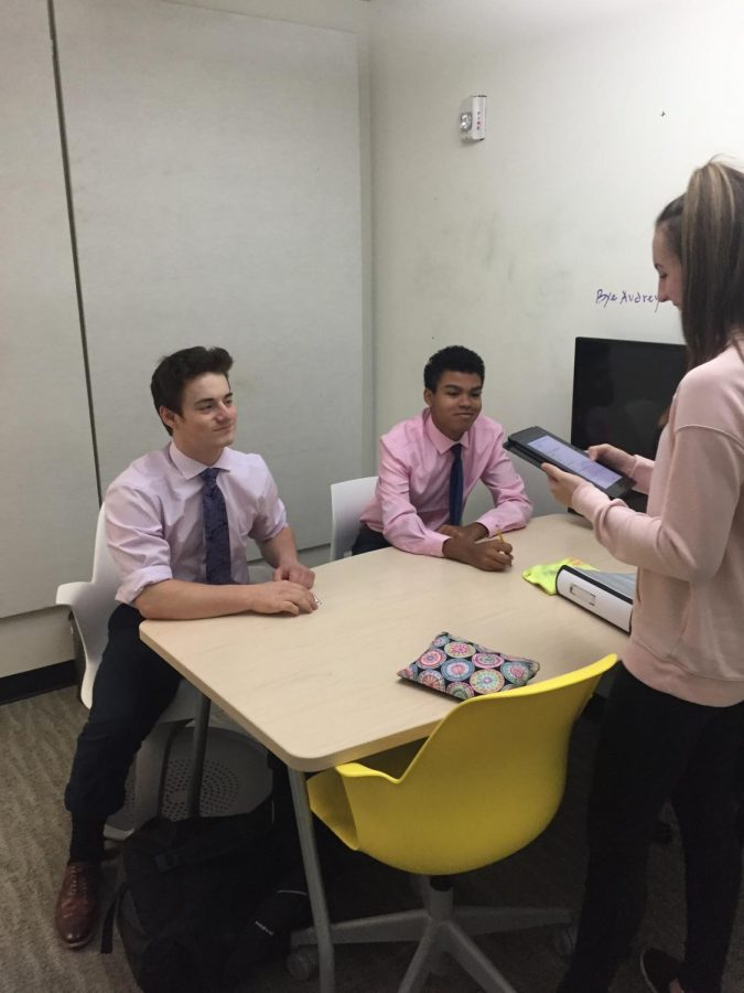 Sophomores Lindsey Pearlman, Aaron Gifford, and Daniel Blaine study in a pod, all in their dress code clothing.