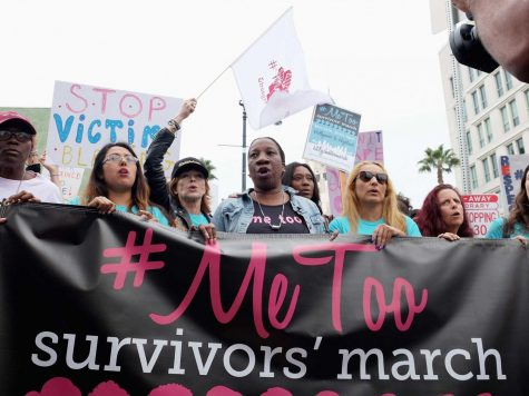 Founder of #MeToo, Tarana Burke, leading a women's march to raise awareness for girls who have experienced sexual abuse and assault.