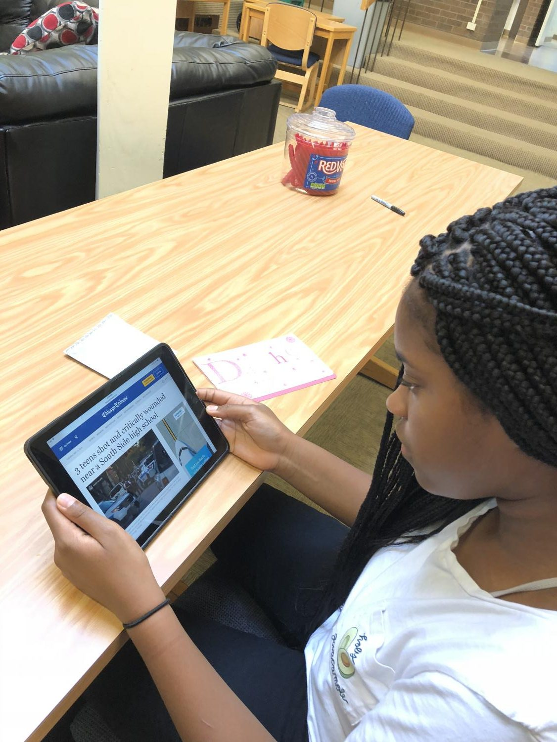Freshman, Safiya Nicol, is reading a Chicago Tribune article about the shooting of three teens in Chicago's South Side.