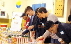 Lake Forest Academy helping set food on the table. Photo Courtesy of smugmug