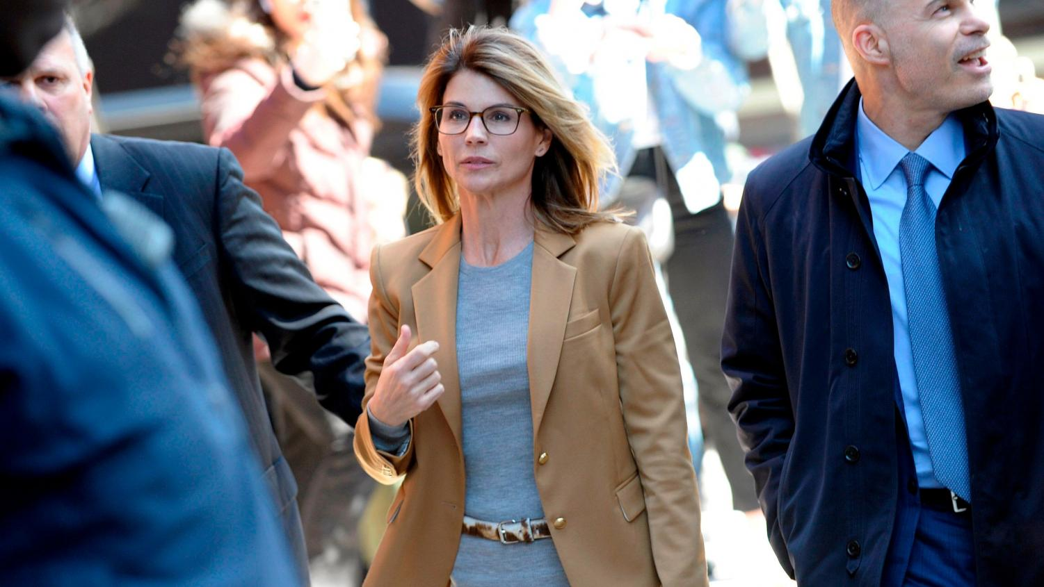 Photo Courtesy of channel3000.com  Lori Loughlin leaving her trial after pleading not guilty.