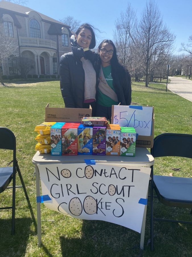 Shylee, 22', sells Girl Scout cookies with her sister outside of her home.