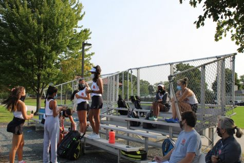 Girls tennis has a practice using social distancing guidelines.