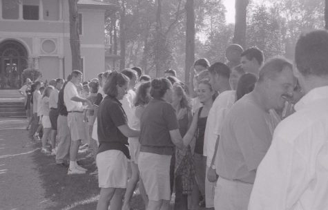 Students, faculty, and staff participate in one of the first All-School-Handshakes.