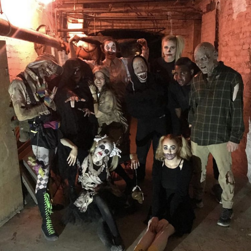 Some of the scarers gather inside the Reid basement, where the 2019 LFA Haunted House took place.