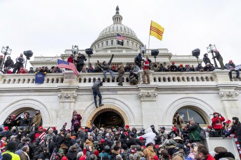 Pro-Trump rioters swarm the Capitol building, incited by the rhetoric of the former President.