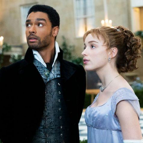 Daphne and the Duke converse at a ball.