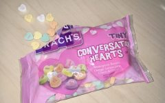 A bag of Brach's Conversation Hearts being shared over a conversation
