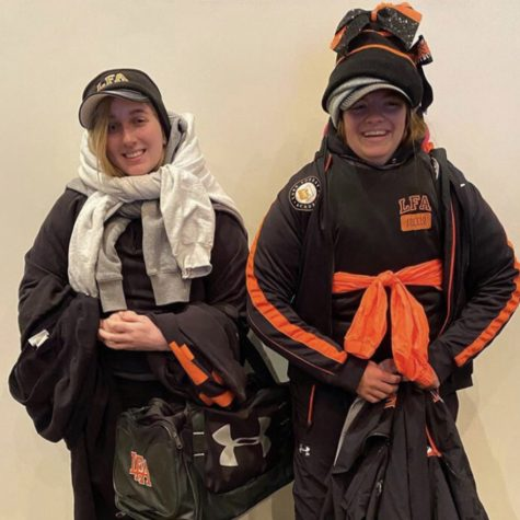 Rachel Johns '21 (left) and Abbe Shanley-Roberts '21 (right) participate in a House Cup Competition to see who can wear the most layers of LFA-themed clothing.