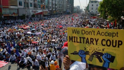 Protestors defy military warning in mass strike.