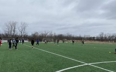 Boys' Varsity Soccer practices outside in preparation for upcoming games.