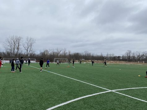 Boys Varsity Soccer practices outside in preparation for upcoming games.